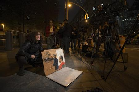 Sketch artist Jane Rosenberg shows reporters her drawing of Gilberto Valle III, 28, when he pleaded not guilty to criminal charges in the U.S. District Court in Manhattan, in New York October 25, 2012. REUTERS/Keith Bedford