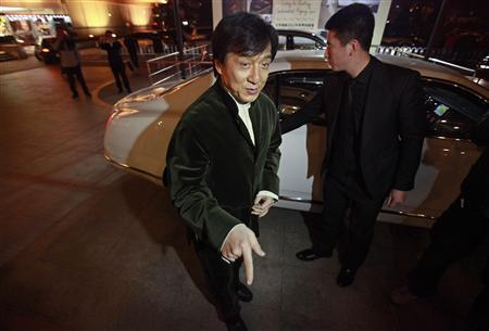 Kung Fu superstar Jackie Chan gestures in front of a car before having his Bentley 666 auctioned for charity in Beijing, November 19, 2012. Chan said that while the upcoming film ''Chinese Zodiac 2012'' will be his last major action movie, citing his increasing age, he will still be packing punches in the world of philanthropy. Chan wrote, directed and produced his latest film, set to premiere in cinemas next month. He also plays the lead role and said that it was probably his ''best film for myself'' in the last ten years. Picture taken November 19, 2012. REUTERS/Petar Kujundzic