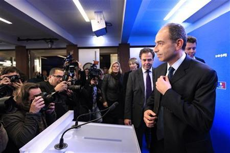 French politician Jean-Francois Cope (R) adjusts his tie as he attends a news conference at the UMP political party headquarters after he won the leadership of France's main conservative party in a closely fought and divisive two-way contest in Paris November 19, 2012. REUTERS/Gonzalo Fuentes (FRANCE - Tags: POLITICS ELECTIONS MEDIA)