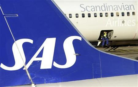 A loader sits in the cargo bay of an SAS Boeing 737 aircraft parked at Arlanda airport's Terminal Five, north of Stockholm November 13, 2012. Crisis-hit Scandinavian airline SAS has no room to cut a deal with unions to ease the pain of pay cuts and job losses as it fights for survival, its chief executive Rickard Gustafson said on Tuesday. REUTERS/Johan Nilsson/Scanpix (SWEDEN - Tags: TRANSPORT BUSINESS EMPLOYMENT) THIS IMAGE HAS BEEN SUPPLIED BY A THIRD PARTY. IT IS DISTRIBUTED, EXACTLY AS RECEIVED BY REUTERS, AS A SERVICE TO CLIENTS. SWEDEN OUT. NO COMMERCIAL OR EDITORIAL SALES IN SWEDEN. NO COMMERCIAL SALES
