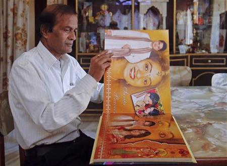 Andanappa Yalagi, the father of Savita Halappanavar, looks at her wedding album at her house in Belgaum in Karnataka November 16, 2012. REUTERS/Danish Siddiqui