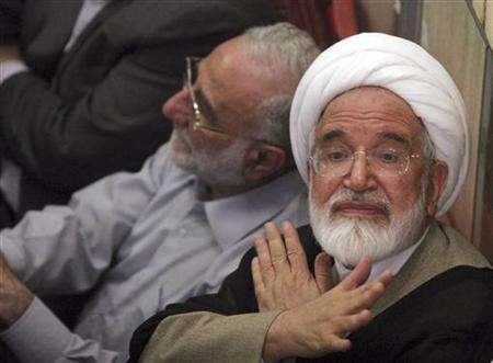 Mehdi Karoubi gestures to protesters gathered at the Ghoba mosque in northern Tehran June 28, 2009. REUTERS/via Your View