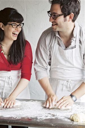 Rae (L) and Noah Bernamoff make challah at their restaurant Mile End Delicatessen in Brooklyn, New York in this undated handout photo received October 24, 2012. Noah Bernamoff hopes ''The Mile End Cookbook,'' which he wrote with his wife Rae about their modern spin on the Jewish deli food he enjoyed during his childhood in Montreal, will inspire others to make the comfort dishes at home. REUTERS/Quentin Bacon/Handout