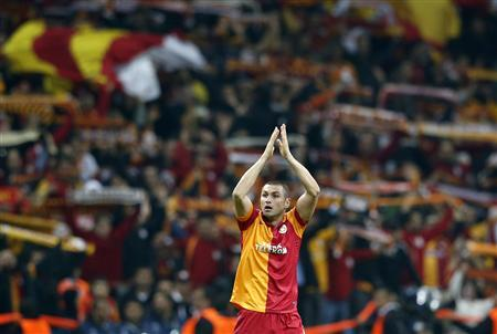 Galatasaray's Burak Yilmaz celebrates after scoring a goal against Manchester United during their Champions League Group H soccer match at Turk Telekom Arena in Istanbul November 20, 2012. REUTERS/Murad Sezer