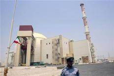 EDITORS' NOTE: Reuters and other foreign media are subject to Iranian restrictions on leaving the office to report, film or take pictures in Tehran. A security official stands in front of the Bushehr nuclear reactor, 1,200 km (746 miles) south of Tehran, August 21, 2010. REUTERS/Raheb Homavandi
