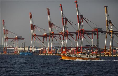 A boat sails near a shipping container area at Yokohama Bay, south of Tokyo October 22, 2012. REUTERS/Issei Kato