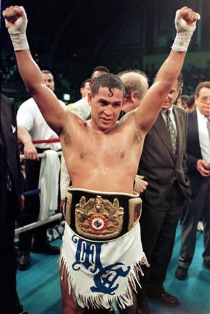 Hector ''Macho'' Camacho of Puerto Rico, wearing his championship belt, celebrates his fifth round victory over Sugar-Ray Leonard of the U.S. during their International Boxing Council (IBC) middleweight title fight in Atlantic City, in this file picture taken March 1, 1997. REUTERS/Gary Hershorn/Files
