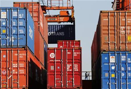 A worker is seen in a container area at a port in Tokyo November 21, 2012. Japan's exports fell in annual terms for a fifth month in October, hurt by the fallout from a diplomatic row with China and feeble global demand, a further sign the economy may be slipping into recession and adding weight to calls for policy easing. REUTERS/Issei Kato (JAPAN - Tags: BUSINESS POLITICS MARITIME)