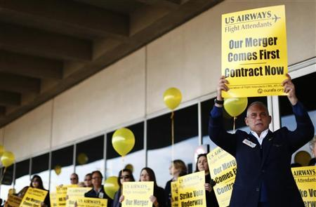 US Airways Flight Attendants hold signs as they picket at Charlotte Douglas International Airport in Charlotte, North Carolina November 14, 2012. REUTERS/Chris Keane