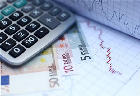 Euro banknotes and a calculator are placed on a currency graph and ticker in this picture illustration taken in Zenica October 19, 2011. REUTERS/Dado Ruvic/Files