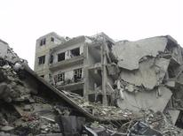 A view of buildings damaged after a Syrian Air Force fighter jet loyal to Syria's President Bashar al-Assad fired missiles in Douma, near Damascus, November 19, 2012. REUTERS/Abed Al-Kareem Muhammad/Shaam News Network/Handout