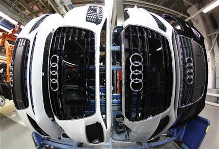 Audi A4 front parts with emblems are pictured at the production line of the German car manufacturer's plant in the Bavarian city of Ingolstadt February 29, 2012. REUTERS/Michaela Rehle