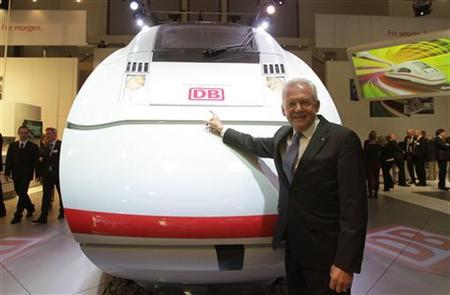 Chief Executive Officer of the German railway firm Deutsche Bahn Ruediger Grube, poses next to a full-scale model of the future ICx train during the opening day of the ''Innotrans'' fair (International Trade Fair for Transport Technology - Innovative Components, Vehicles, Systems) in Berlin, September 18, 2012. REUTERS/Tobias Schwarz