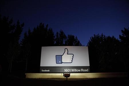 The sun rises behind the entrance sign to Facebook headquarters in Menlo Park before the company's IPO launch, May 18, 2012. REUTERS/Beck Diefenbach (UNITED STATES - Tags: BUSINESS)