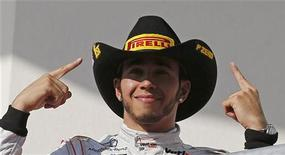 McLaren Formula One driver Lewis Hamilton of Britain gestures during the podium ceremony after winning the U.S. F1 Grand Prix at the Circuit of the Americas in Austin, Texas November 18, 2012. REUTERS/Jim Young