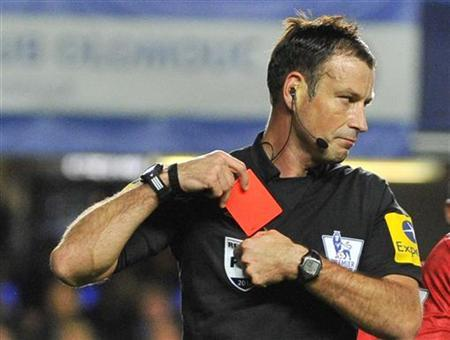 Referee Mark Clattenburg holds a red card after sending off Chelsea's Branislav Ivanovic during their English Premier League soccer match against Manchester United at Stamford Bridge in London October 28, 2012. REUTERS/Toby Melville/Files