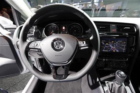The dashboard, steering wheel and the navigation system are pictured inside the new Volkswagen Golf model during the launch ceremony in Berlin September 4, 2012. The new model is planned to go on sale across Europe in November, replacing the 2008 sixth-generation model. Volkswagen is hoping a sleek makeover will keep its Golf in the best-selling compact car spot, helping the German automaker overtake Toyota and GM as the world leaders. REUTERS/Fabrizio Bensch (GERMANY - Tags: TRANSPORT BUSINESS)