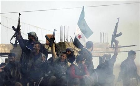 Members of the Free Syrian Army shout slogans against Syrian President Bashar al-Assad while holding a Syrian opposition flag as gunfire is heard, as seen from the Turkish border town of Ceylanpinar, Sanliurfa province, November 22, 2012. NATO ambassadors met on Wednesday to consider a Turkish request for the deployment of Patriot missiles near its border with Syria as the conflict in its southern neighbour deepens. A Reuters photographer said sporadic gunfire was heard throughout the day at the border. REUTERS/Amr Abdallah Dalsh (TURKEY - Tags: POLITICS CONFLICT MILITARY)