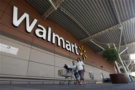 Shoppers cart their purchases from a Wal-Mart store in Mexico City, April 24, 2012. REUTERS/Edgard Garrido