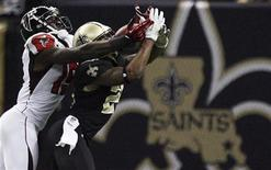 New Orleans Saints cornerback Corey White (24) intercepts a pass away from Atlanta Falcons wide receiver Drew Davis (19) during the second half of their NFL football game in New Orleans, Louisiana November 11, 2012. REUTERS/Sean Gardner