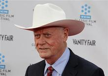 """Cast member of the TV series """"Dallas"""" Larry Hagman arrives at the world premiere of the 40th anniversary restoration of the film """"Cabaret"""" during the opening night gala of the 2012 TCM Classic Film Festival in Hollywood, California in this file April 12, 2012 photo. REUTERS/Fred Prouser"""