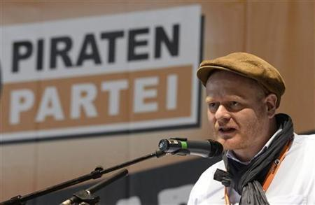 Delegate Bernd Schloemer of Germany's Pirate Party (Piraten Partei), delivers his speech at their party convention in Neumuenster, April 28, 2012. REUTERS/Fabian Bimmer