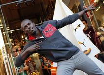 El velocista jamaicano Usain Bolt y la estadounidense Allyson Felix, campeones olímpicos de Londres, ganaron el sábado los premios que les acreditan como los mejores atletas del mundo en 2012 según la Asociación Internacional de Federaciones de Atletismo. En la imagen, de 23 de noviembre, el jamaicano Usain Bolt posa en la inauguración de una tienda de Puma en Barcelona. REUTERS/Albert Gea