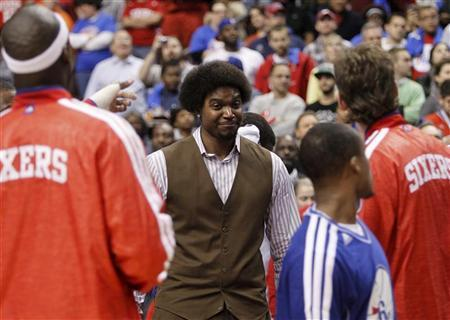 Injured Philadelphia 76ers center Andrew Bynum (C) smiles before the start of the NBA basketball game between the 76ers and the Denver Nuggets in Philadelphia, Pennsylvania, October 31, 2012. REUTERS/Tim Shaffer