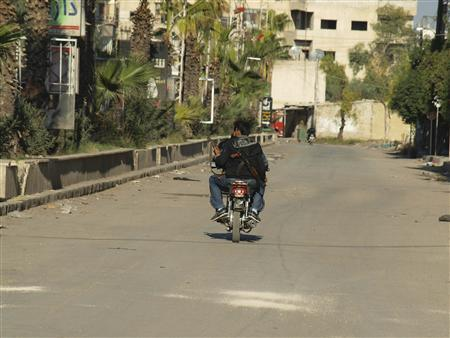 Free Syrian Army fighters ride a motorcycle in Daria, near Damascus November 24, 2012. REUTERS/Fadi Al-Derani/Shaam News Network/Handout
