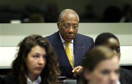 Former Liberian President Charles Taylor listens to the judge at the opening of the sentencing judgement hearing at the court in Leidschendam, near The Hague, May 30, 2012. REUTERS/Toussaint Kluiters/United Photos