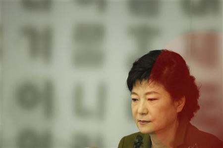 Park Geun-hye, South Korea's ruling Saenuri Party's presidential candidate, listens to a reporter's question during a news conference at the Seoul Foreign Correspondents' Club in Seoul November 8, 2012. The source of the red circle comes from a video camera's LED light. REUTERS/Kim Hong-Ji