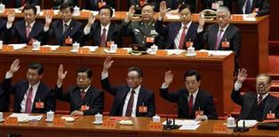 (Front row, from L to R) China's Vice President Xi Jinping, top political advisor Jia Qinglin, chairman of the Standing Committee of National People's Congress Wu Bangguo, China's President Hu Jintao and former President Jiang Zemin raise their hands as they take a vote at the closing session of the 18th National Congress of the Communist Party of China at the Great Hall of the People in Beijing, November 14, 2012. REUTERS/Jason Lee
