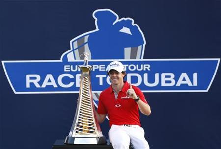 Rory McIlroy of Northern Ireland poses with the trophy after winning the DP World Tour Championship at Jumeirah Golf Estates in Dubai November 25, 2012. REUTERS/Nikhil Monteiro