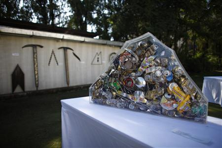 Art made from trash picked from Mount Everest are pictured at a visual art symposium in Kathmandu November 20, 2012. REUTERS/Stringer