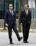 Bank of Canada Governor Mark Carney (L) waits to cross the street while walking with Senior Deputy Governor Tiff Macklem to a news conference upon the release of the Monetary Policy Report in Ottawa October 24, 2012. REUTERS/Chris Wattie