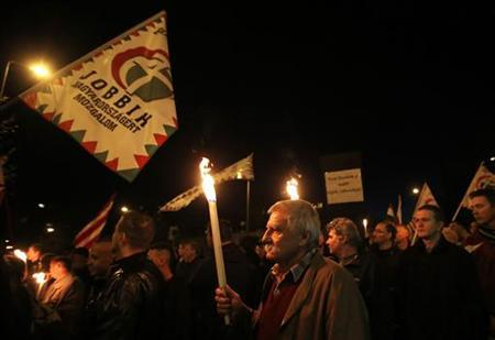 Supporters of the Hungarian far right Jobbik party march during a demonstration at the Avas apartment projects in Miskolc, 180 km (112 miles) east of Budapest, October 17, 2012. REUTERS/Laszlo Balogh