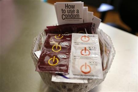 A bowl of free New York City condoms are seen in a lobby at the AIDS Service Center of New York City (ASC/NYC) lower Manhattan headquarters July 3, 2012. REUTERS/Mike Segar/Files