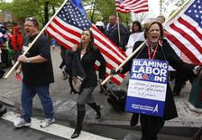 Donna J. Gaspero (R), an American Airlines flight attendant for 37 years, marches with Laura Glading (C), president of the Association of Professional Flight Attendants (APFA), during a rally to save jobs at American Airlines and American Eagle, as hearings to void labor contracts begin at the U.S. Bankruptcy Court in New York in this April 23, 2012, file photo. Pilots at United Airlines and American Airlines are due to vote in coming weeks on new labor contracts that in some cases offer the first significant raises in almost a decade. But the carriers, citing high risks that the recovery in their fortunes could stall, are not prepared to improve contracts across the board, industry experts and airline executives say. That means labor relations could remain rocky. Flight attendants for U.S. Airways Group voted overwhelmingly last week to authorize a strike, saying their latest contract offer still reflects the days when airline profits were in free-fall. To match Analysis AIRLINES-LABOR/ REUTERS/Mike Segar/Files