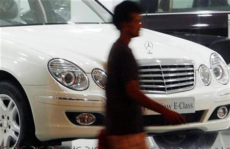 A man walks past a car displayed at a Mercedes-Benz showroom in Mumbai in this November 25, 2008 file photo. REUTERS/Arko Datta/Files