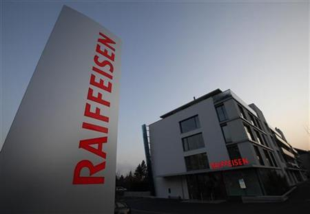 A Raiffeisen bank logo is pictured in front of a local branch in Nyon February 10, 2012. REUTERS/Denis Balibouse (SWITZERLAND - Tags: BUSINESS)