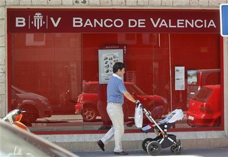 Spain to overhaul rescued banks as condition of aid