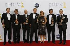 """Alex Gansa (C) and fellow writers pose with their award for outstanding writing for a drama series for """"Homeland,"""" backstage at the 64th Primetime Emmy Awards in Los Angeles, September 23, 2012. REUTERS/Mario Anzuoni"""