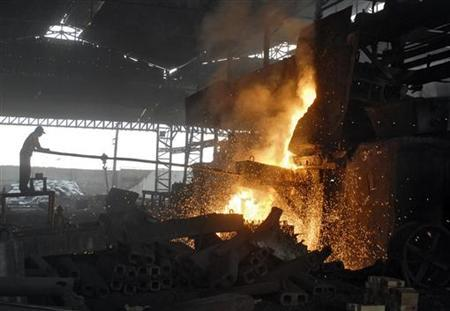 A labourer works in an iron factory on the outskirts of Hyderabad May 13, 2010. REUTERS/Krishnendu Halder/Files