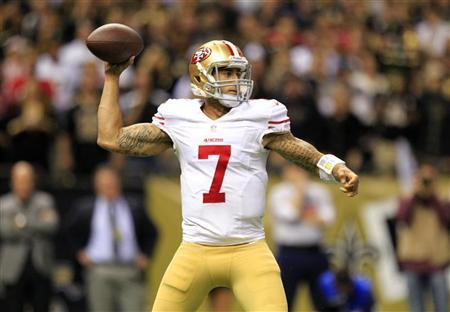 San Francisco 49ers quarterback Colin Kaepernick (7) drops back to pass against the New Orleans Saints during the second half of their NFL football game in New Orleans, Louisiana November 25, 2012. REUTERS/Sean Gardner