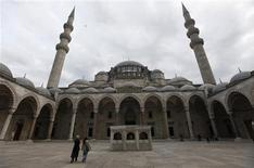 """Visitors walk at the courtyard of the Ottoman-era Suleymaniye Mosque in Istanbul November 28, 2012. Tayyip Erdogan has described his third term as Turkish prime minister as that of a """"master"""", borrowing from the celebrated Ottoman architect Sinan and the last stage of his storied career after apprenticeship and graduation. Now, entering a second decade at the helm of a country revelling in its regional might, Erdogan wants to leave his own mark on the cityscape with what will be Turkey's biggest mosque, a """"giant mosque,"""" he says, """"that will be visible from all across Istanbul."""" But the Istanbul elite are up in arms and some have branded the proposed mosque unsightly and ostentatious. Picture taken November 28, 2012. REUTERS/Murad Sezer"""