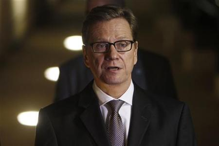 Germany's Foreign Minister Guido Westerwelle speaks as he delivers joint statements to the media with his Israeli counterpart Avigdor Lieberman (not seen) in Jerusalem November 19, 2012. Israel bombed dozens of targets in the Gaza Strip on Monday and said that while it was prepared to step up its offensive by sending in troops, it preferred a diplomatic solution that would end Palestinian rocket fire. REUTERS/Ronen Zvulun (JERUSALEM - Tags: POLITICS CIVIL UNREST)