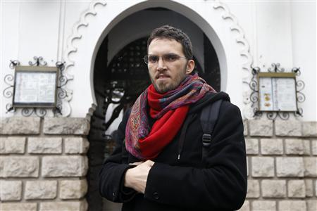 Ludovic-Mohamed Zahed, a French-Algerian homosexual Muslim, poses in front of Paris Mosque November 23, 2012. Zahed, who heads the ''Homosexual Muslims of France'' association, is the initiative behind Europe's first gay and lesbian-friendly mosque which is due to open next month in an eastern Paris suburb, in a challenge to a tradition of discomfort in mainstream Islam with same-sex relationships. REUTERS/Charles Platiau