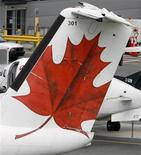 The Air Canada logo is shown on the tail of a plane on the tarmac at Pearson International Airport in Toronto, June 17, 2008. REUTERS/Mike Cassese