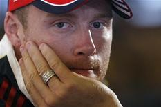 England cricketer Andrew Flintoff listens to questions during a news conference in central London, August 24, 2009. REUTERS/Andrew Winning