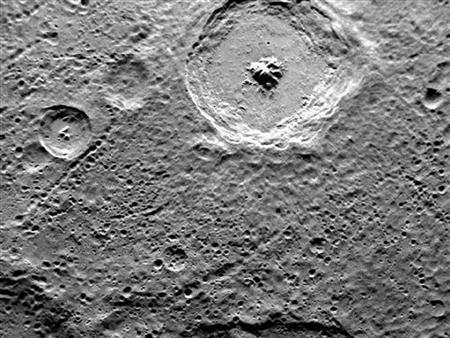 NASA's Mercury Surface, Space Environment, Geochemistry and Ranging spacecraft -- nicknamed Messenger's image titled ''Toc-crater and Fugue'' taken with the MDIS Narrow Angle Camera (NAC) on May 3, 2011 and released June 16, 2011 shows two named craters imaged by both MESSENGER and Mariner 10. REUTERS/NASA/Johns Hopkins University Applied Physics Laboratory/Carnegie Institution of Washington/Handout/Files